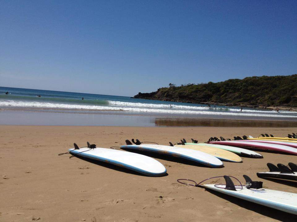 agnes water beach with surf boards on the sand